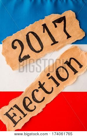 Election 2017, inscription on torn paper sheet and the French flag. Elections in France