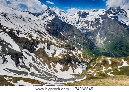 high capped mountain peaks and blue sky