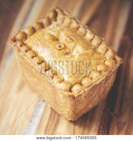 Gala Pork Pie on a wooden board