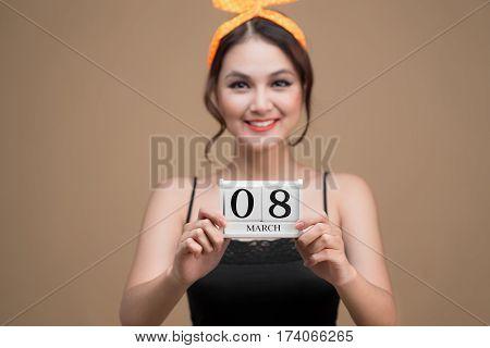 Asian beautiful woman holding March 8th Calendar Women Day