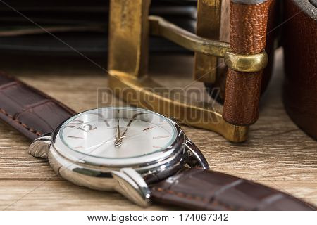 Wristwatch And Brown Leather Belt