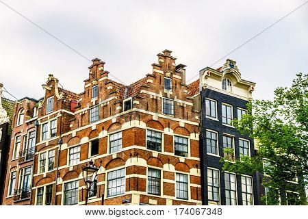 Step and Bell Gable of Historic Dutch Canal House in Amsterdam, the Netherlands