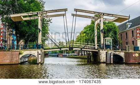 Historic Draw Bridge from the Middle Ages over a canal in the old city of Amsterdam, the netherlands