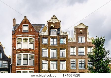 Neck Gables and Spout Gable of Historic Houses along the canals of in Amsterdam, the Netherlands