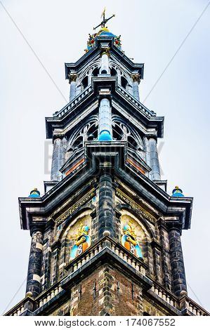 Tower of the Historic Westerkerk in Amsterdam, the Netherlands under cloudy skies