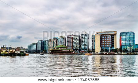View of Modern Office Buildings along the Harbor named Het IJ in Amsterdam, the Netherlands