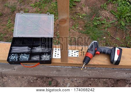 drill tool plastic box with nails and screw on new house foundation