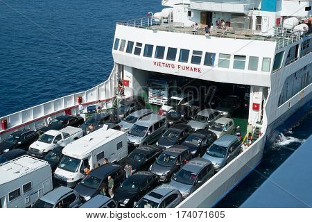 Messina Italy - August 08 2014: Ferryboat with many tourists and cars on board. This ship connecting Calabria and Sicily on Strait of Messina waiting of the bridge