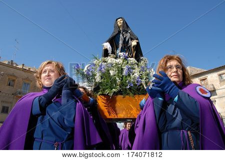 VILLAROSA ITALY - March 21 2008: Holy Week in Sicily. Women carry in procession the statue of the Madonna in the representation of the passion and death of Jesus.