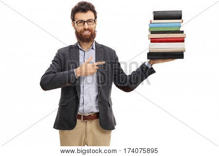 Young professor holding a stack of books and pointing isolated on white background