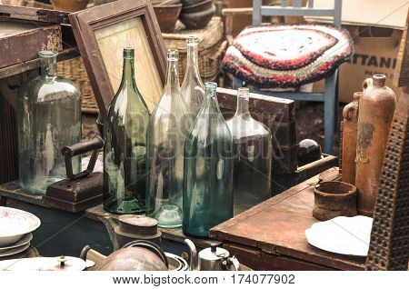 Old objects at a flea market close up.