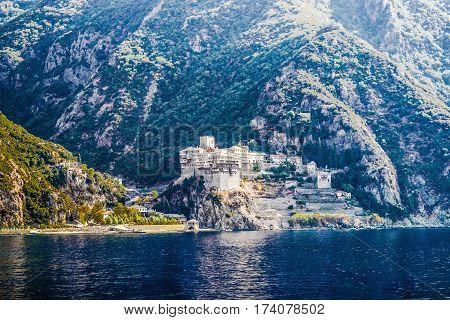 Orthodox Greek monastery on Mount Athos. View from sea. Dionysiou.