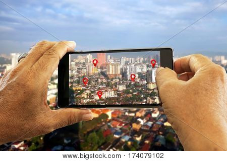 Hand holding smart phone seaching for location