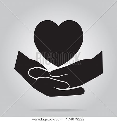 Hand clasped and heart icon protection care or meditation concept