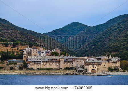 Orthodox Greek monastery on Mount Athos. View from sea. Xenophon.