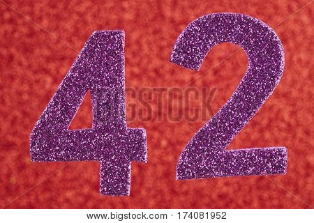 Number forty-two purple color over a red background. Anniversary. Horizontal