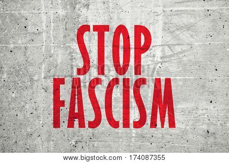 Stop fascism message written on concrete wall