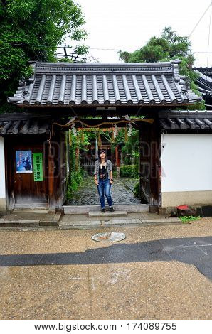 Traveler Thai Woman Portrait On The Gate At Front Of Japanese Shrine At Kansai Region