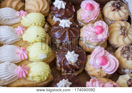 sweet biscuits with cream in a pile top view at close range