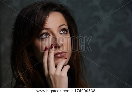 Portrait of beautiful woman with red nails.