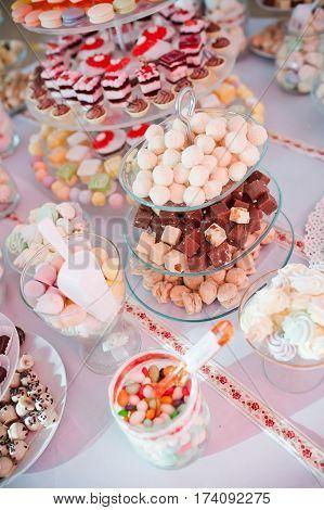 Beautiful sweet cupcakes cookies on buffet table