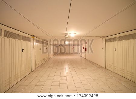 basement garage with many places for cars in an underground parking lot of the apartment building