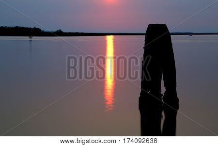 Reflection Of The Sun On The Lagoon At Dawn