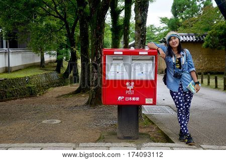 Traveller Thai Woman Portrait With Red Post Box In Garden Of Todai-ji Temple