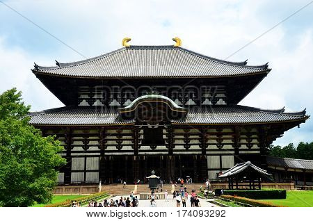 Japanese People And Traveler Foreigner Walking To Inside Todai-ji Shrine Hall For Travel And Visit T