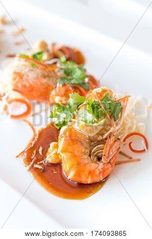 Fried tiger prawn grilled shrimp with tamarind sauce, gourmet Thai cuisine.
