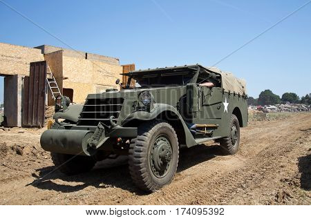 WESTERNHANGER, UK - JULY 18: A US army WW2 vintage M20 armoured car parades around the main show arena for the watching public at the War & Peace Revival show on July 18, 2014 in Westernhanger
