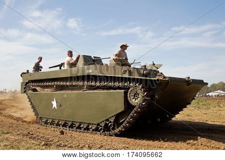 WESTERNHANGER, UK - JULY 18: A US army WW2 vintage Buffalo landing craft parades around the main show arena for the watching public at the War & Peace Revival show on July 18, 2014 in Westernhanger