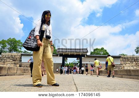 Traveller Thai Woman Portrait At Front Of Gate Entrance To Osaka Castle