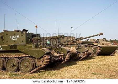 WESTERNHANGER, UK - JULY 18: A mixture of allied WW2 tanks, Comet, Cromwell, Valentine & Buffalo, are lined up for the public to view at the War & Peace show on July 18, 2014 in Westernhanger