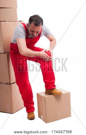 Full Body Of Mover Guy Holding His Knee Like Hurting
