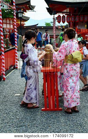 Japanese Women People Wear Traditional Japanese Clothing (kimono And Yukatas) Hold And Shaking Fortu