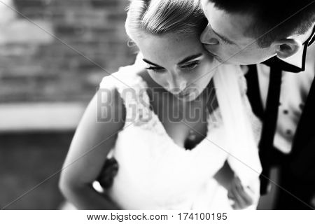 Fiance Kisses Bride Delicately In The Forehead