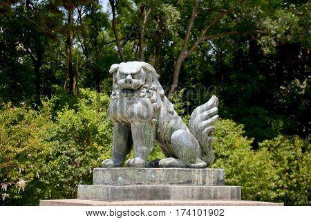 Stone Lions Guardian Statue Japanese Style  At Hokoku Shrine In Osaka Castle Park