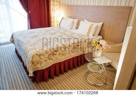 beautiful and cozy bedroom in the interior of the hotel