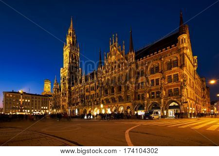 Marienplatz central square illuminated at night with New Town Hall (Neues Rathaus) - a famous tourist attraction. Munich, Germany