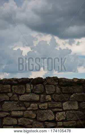 Old stone wall against dark clouds at Kalemegdan fortress in Belgrade, Serbia