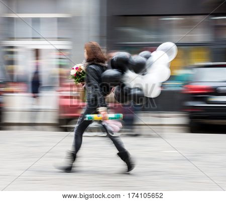 Woman With Black And White Balloons