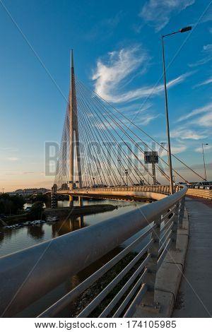 Cable bridge over Sava river at sunset in Belgrade, Serbia