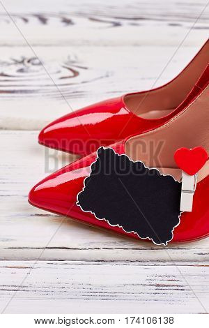 Stylish shoes and heart. Present for beloved.