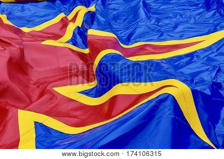 circus tent canvas on the floor bevor buildup, in blue red yellow