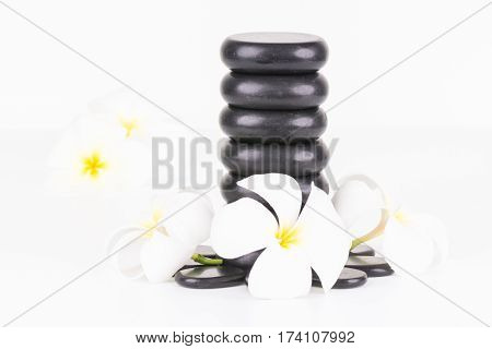 Spa with balance zen stones and Frangipani flowers on white background