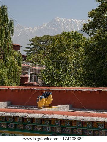 DHARAMSALA, INDIA. 2 June 2009: Institute of Norbulingka in the background of the Himalayas. Western Himalaya, Himachal Pradesh, district of Kangra.
