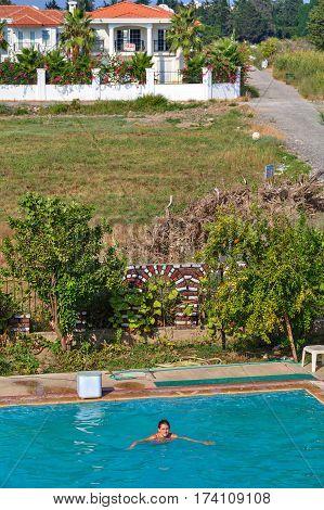 Camyuva Kemer Antalya Turkey - 29 august 2014: Top view of the outdoor swimming pool where one girl swims.