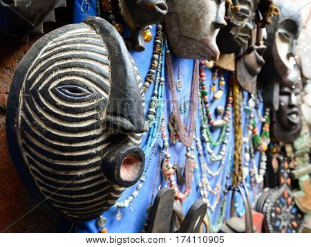 Decorative elements on the souk (market) in the old town Medina in Morocco. Traditional mask