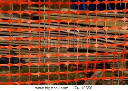 Orange Plastic Protective Net For Delimiting The Area Of A Dange